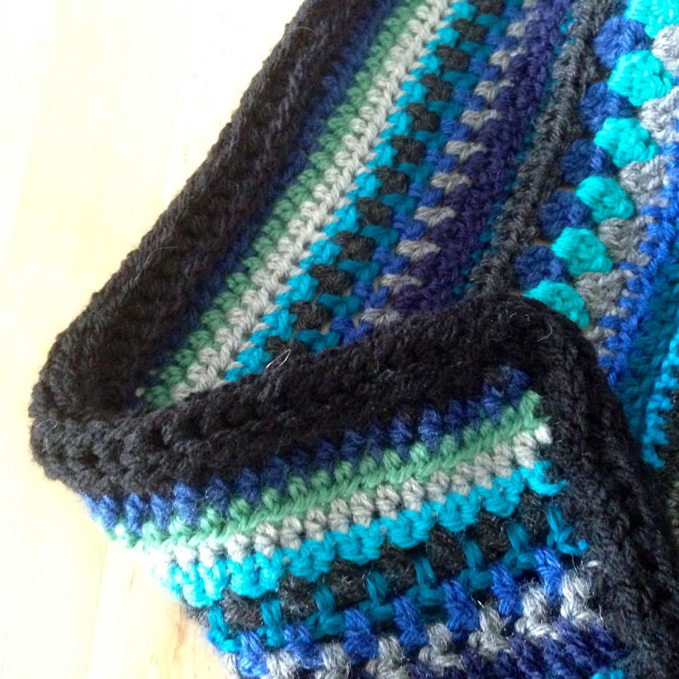 picked up stitches all around the blanket on one side, crocheted ...